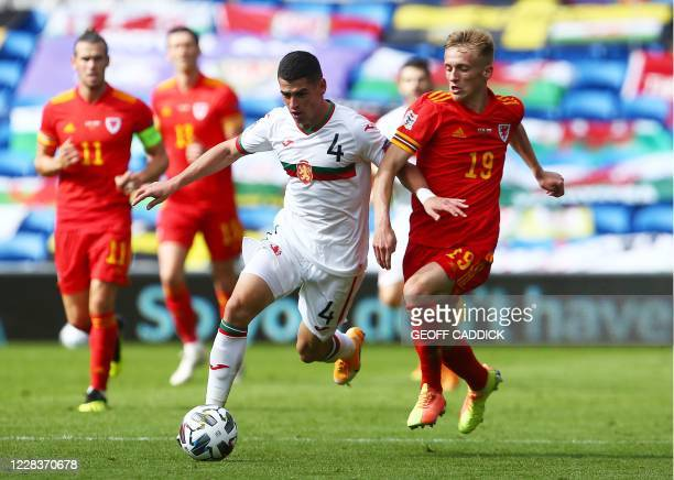 Bulgaria's defender Ivan Goranov is challenged by Wales' midfielder Matthew Smith during the UEFA Nations League football match between Wales and...