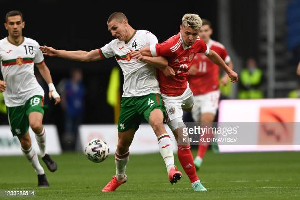 Bulgaria's defender Valentin Antov and Russia's midfielder Andrey Mostovoy vie for the ball during the friendly football match Russia v Bulgaria in...