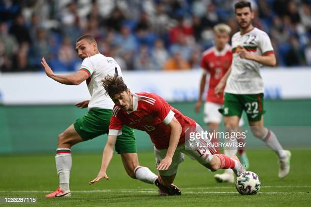 Bulgaria's defender Valentin Antov fouls Russia's midfielder Alexei Miranchuk during the friendly football match Russia v Bulgaria in Moscow on June...