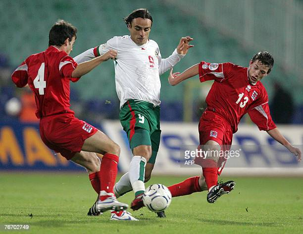 Bulgaria's Dimitar Berbatov vies for the ball with Luxemburg's Eric Hoffmann and Ben Payal during their Euro 2008 Group G qualifying football match...