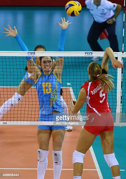 Bulgaria's Dobriana Rabadzhieva in action against Radmila Beresneva of Kazakhstan during the 2014 FIVB Volleyball Women's World Championship Group F...
