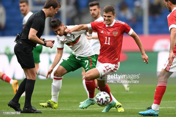 Bulgaria's Dominic Yankov and Russia's midfielder Roman Zobnin vie for the ball during the friendly football match Russia v Bulgaria in Moscow on...