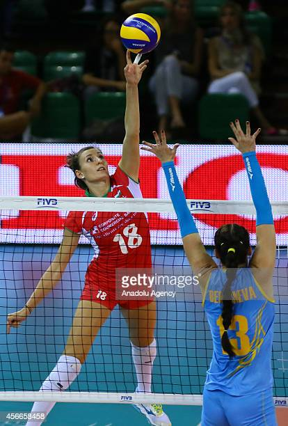 Bulgaria's Emiliya Nikolov in action against Radmila Beresneva of Kazakhstan during the 2014 FIVB Volleyball Women's World Championship Group F...