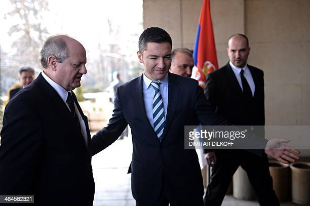 Bulgaria's Foreign Minister Kristian Vigenin welcomes his Serbian counterpart Ivan Mrkic prior to their meeting in Sofia on January 23 2014 DIMITAR...