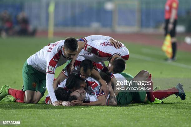 Bulgaria's forward Spas Delev is congratulated by his teammates after scoring a goal during the FIFA World Cup 2018 qualification football match...