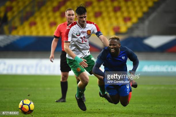 TOPSHOT Bulgaria's forward Stefan Velekov vies with France's forward Moussa Dembele during the Euro 2019 U21 qualifying football match between France...