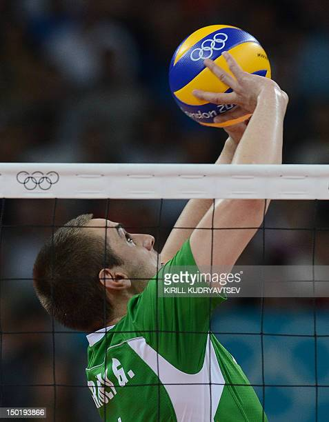 Bulgaria's Georgi Bratoev sets the ball during the men's volleyball bronze medal match of the London 2012 Olympics Games against Italy in London on...
