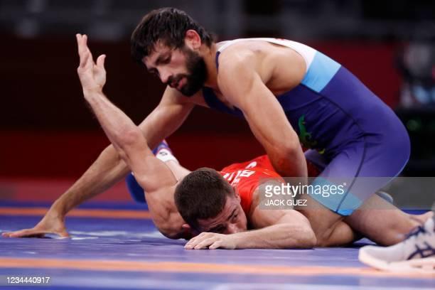 Bulgaria's Georgi Valentinov Vangelov wrestles India's Kumar Ravi in their women's freestyle 57kg wrestling quarter final match during the Tokyo 2020...