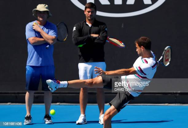 Bulgaria's Grigor Dimitrov and his coach Andre Agassi attend a practice session ahead of the Australian Open tennis tournament in Melbourne on...