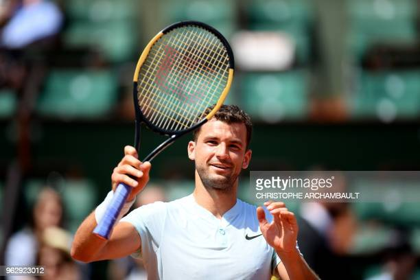 Bulgaria's Grigor Dimitrov celebrates after winning his men's singles first round match against Egypt's Mohamed Safwat on day one of The Roland...
