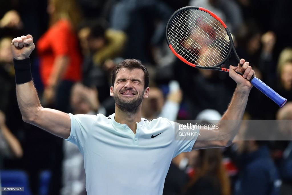 Bulgaria's Grigor Dimitrov celebrates his three set victory over US player Jack Sock in their men's singles semi-final match on day seven of the ATP World Tour Finals tennis tournament at the O2 Arena in London on November 18, 2017. / AFP PHOTO / Glyn KIRK