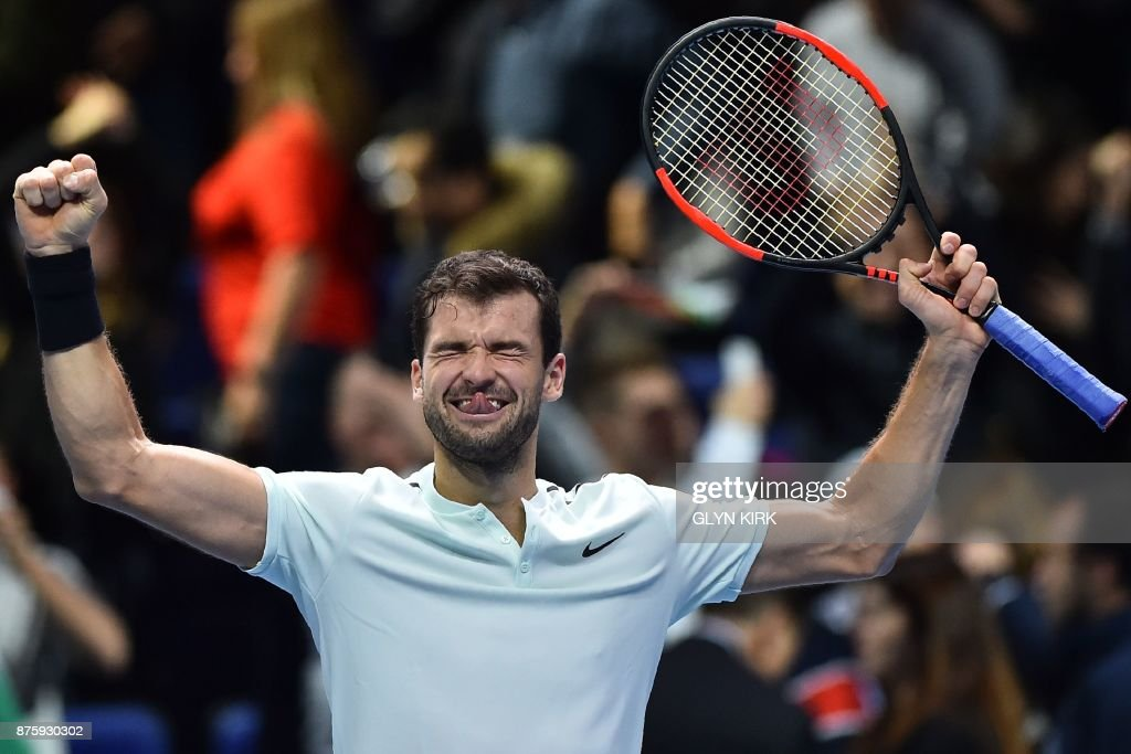 TOPSHOT - Bulgaria's Grigor Dimitrov celebrates his three set victory over US player Jack Sock in their men's singles semi-final match on day seven of the ATP World Tour Finals tennis tournament at the O2 Arena in London on November 18, 2017. / AFP PHOTO / Glyn KIRK