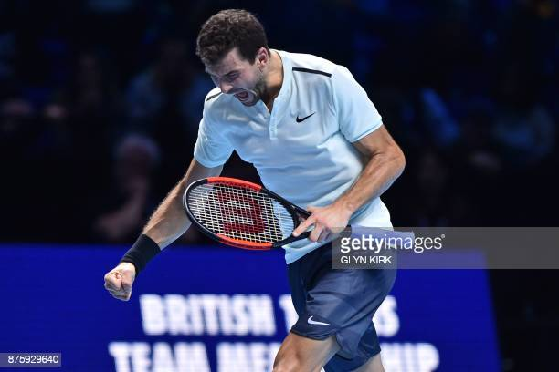 Bulgaria's Grigor Dimitrov celebrates on matchpoint after completing his three set victory over US player Jack Sock in their men's singles semifinal...
