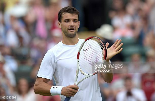 Bulgaria's Grigor Dimitrov celebrates winning his men's singles first round match against US player Ryan Harrison on day one of the 2014 Wimbledon...