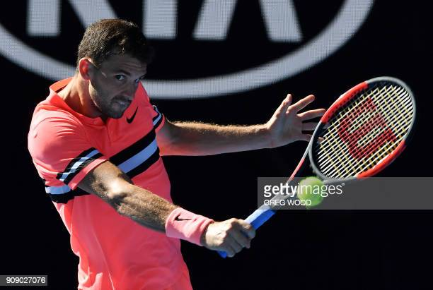 TOPSHOT Bulgaria's Grigor Dimitrov hits a return against Britain's Kyle Edmund during their men's singles quarterfinals match on day nine of the...