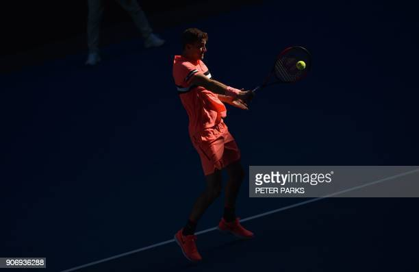 Bulgaria's Grigor Dimitrov hits a return against Russia's Andrey Rublev during their men's singles third round match on day five of the Australian...