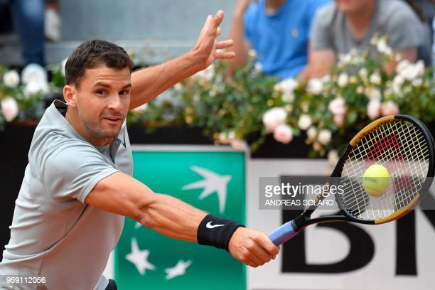 Bulgaria's Grigor Dimitrov hits a return to Japan's Kei Nishikori during Rome's ATP Tennis Open tournament at the Foro Italico on May 16 2018 in Rome