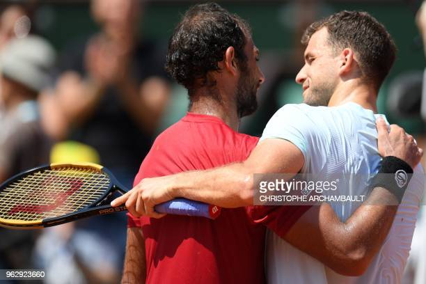 Bulgaria's Grigor Dimitrov is congratulated by Egypt's Mohamed Safwat after winning the men's singles first round tennis match on day one of The...