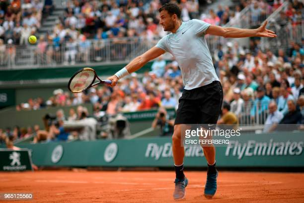 TOPSHOT Bulgaria's Grigor Dimitrov plays a backhand return to Spain's Fernando Verdasco during their men's singles third round match on day six of...