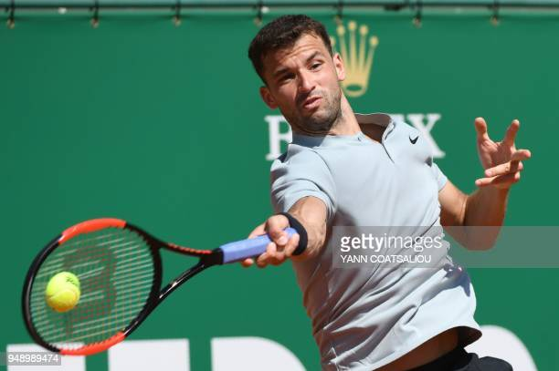 TOPSHOT Bulgaria's Grigor Dimitrov plays a forehand return to Belgium's David Goffin during their singles tennis match at the MonteCarlo ATP Masters...