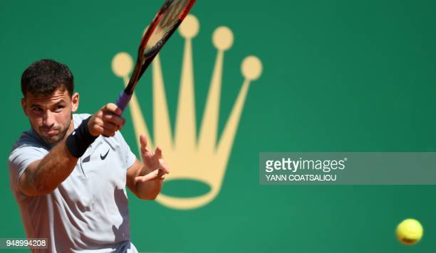 Bulgaria's Grigor Dimitrov plays a forehand return to Belgium's David Goffin during their singles tennis match at the MonteCarlo ATP Masters Series...