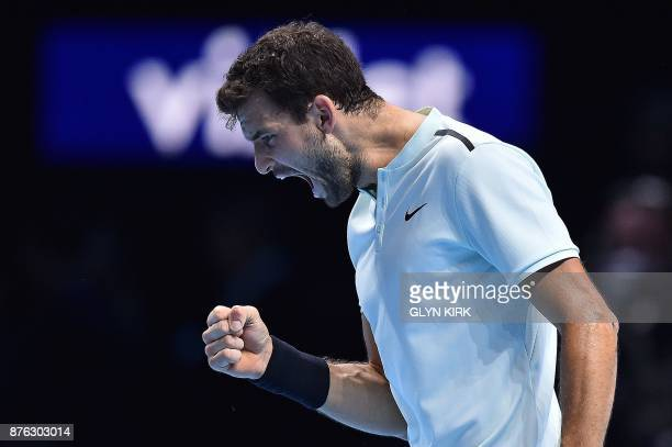 Bulgaria's Grigor Dimitrov reacts after winning the first set against Belgium's David Goffin during their men's singles final match on day eight of...
