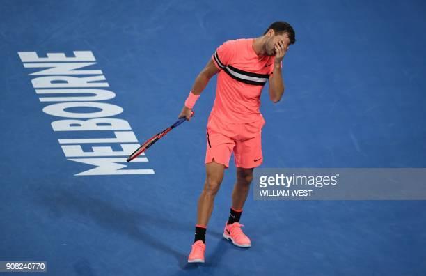 Bulgaria's Grigor Dimitrov reacts against Australia's Nick Kyrgios during their men's singles fourth round match on day seven of the Australian Open...