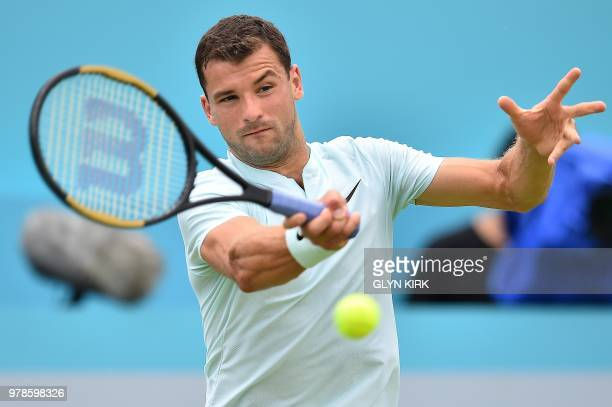 Bulgaria's Grigor Dimitrov returns against Bosnia and Herzegovina's Damir Dzumhur during their first round men's singles match at the ATP Queen's...