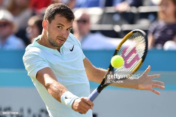 Bulgaria's Grigor Dimitrov returns against Serbia's Novak Djokovic during their men's singles secondround match at the ATP Queen's Club Championships...