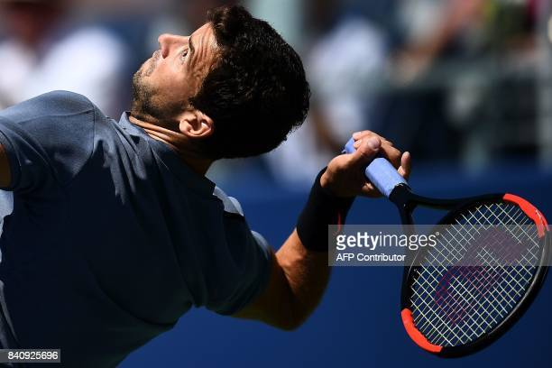 Bulgaria's Grigor Dimitrov returns the ball to Czech Republic's Vaclav Safranek during their 2017 US Open Men's Singles match at the USTA Billie Jean...