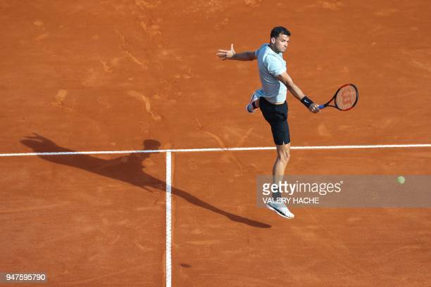 Bulgaria's Grigor Dimitrov returns the ball to France's PierreHugues Herbert during their round of 32 tennis match at the MonteCarlo ATP Masters...