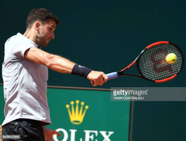 Bulgaria's Grigor Dimitrov returns the ball to Germany's Philipp Kohlschreiber during the MonteCarlo ATP Masters Series Tournament on April 19 2018...
