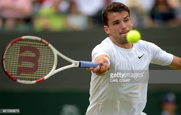 Bulgaria's Grigor Dimitrov returns to US player Ryan Harrison during their men's singles first round match on day one of the 2014 Wimbledon...