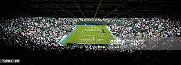 Bulgaria's Grigor Dimitrov serves against France's Gilles Simon during their men's singles second round match on the fourth day of the 2016 Wimbledon...