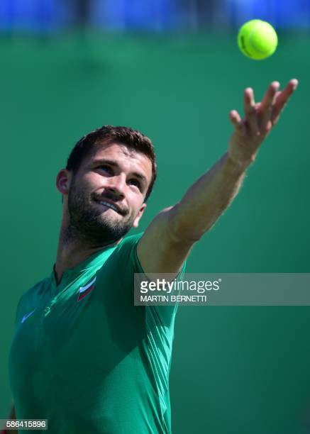 Bulgaria's Grigor Dimitrov serves the ball to Croatia's Marin Cilic during their men's first round singles tennis match at the Olympic Tennis Centre...