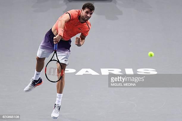 Bulgaria's Grigor Dimitrov serves the ball to Serbia's Novak Djokovic during their third round tennis match at the ATP World Tour Masters 1000 indoor...
