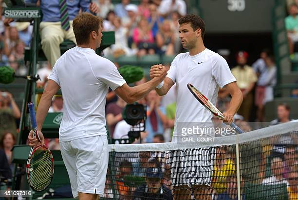 Bulgaria's Grigor Dimitrov shakes hands with US player Ryan Harrison after winning their men's singles first round match on day one of the 2014...