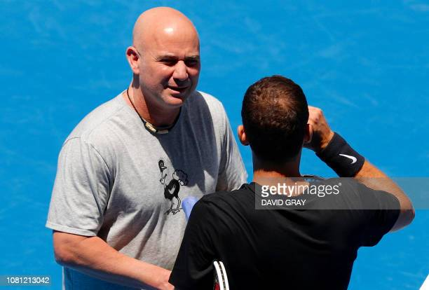 Bulgaria's Grigor Dimitrov talks with his coach Andre Agassi during a practice session ahead of the Australian Open tennis tournament in Melbourne on...