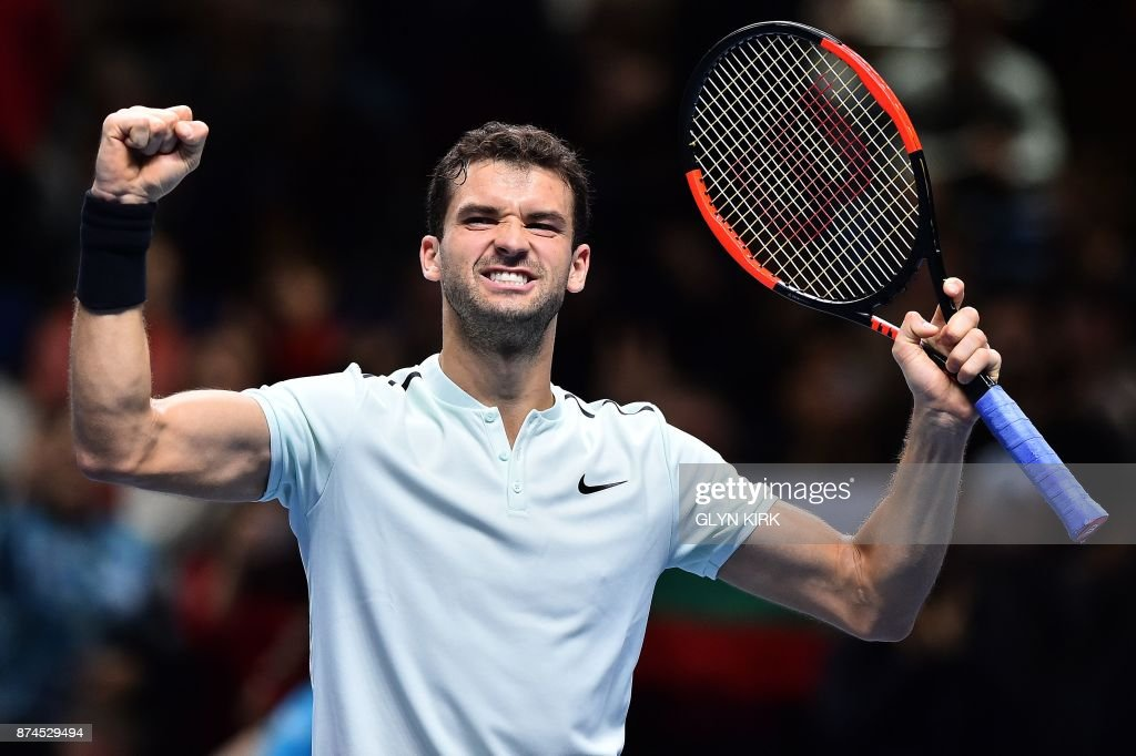 Bulgaria's Grigor Dmitrov reacts after winning against Belgium's David Goffin during their men's singles round-robin match on day four of the ATP World Tour Finals tennis tournament at the O2 Arena in London on November 15, 2017. Dmitrov won the match 6-0, 6-2. / AFP PHOTO / Glyn KIRK