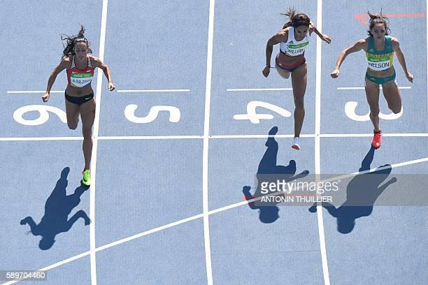 Bulgaria's Ivet LalovaCollio Great Britain's Jodie Williams and Australia's Ella Nelson cross the finish line of her Women's 200m Round 1 heat during...