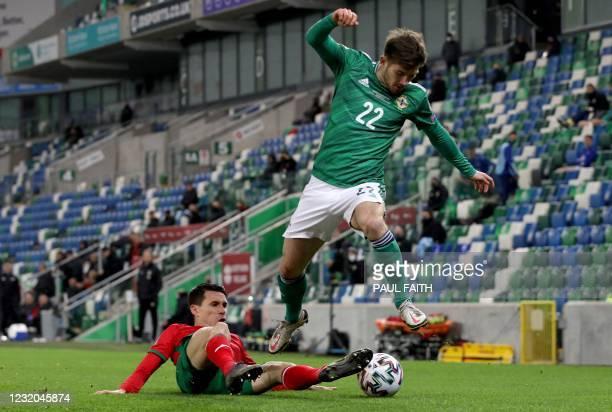 Bulgaria's midfielder Birsent Karagaren vies with Northern Ireland's midfielder Matthew Kennedy during the FIFA World Cup Qatar 2022 Group C...
