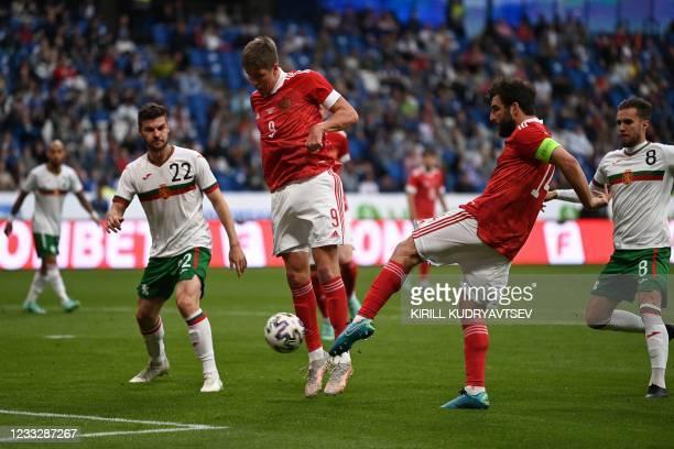 Bulgaria's midfielder Petar Vitanov and Russia's forward Alexander Sobolev and Russia's defender Georgi Dzhikiya in action during the friendly...