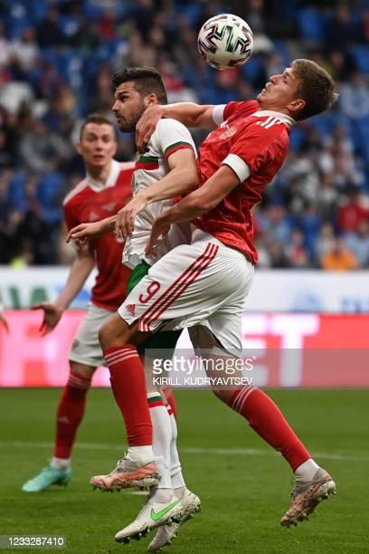 Bulgaria's midfielder Petar Vitanov and Russia's forward Alexander Sobolev vie for the ball during the friendly football match Russia v Bulgaria in...