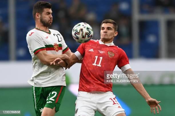 Bulgaria's midfielder Petar Vitanov and Russia's midfielder Roman Zobnin vie for the ball during the friendly football match Russia v Bulgaria in...