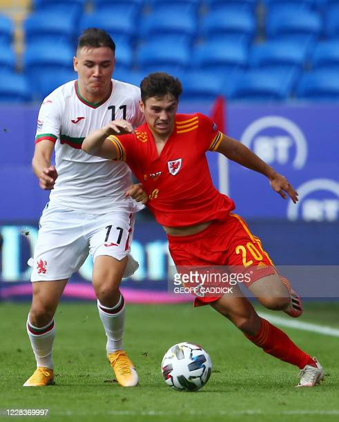 Bulgaria's midfielder Yanis Karabelyov and Wales' midfielder Daniel James compete for the ball during the UEFA Nations League football match between...