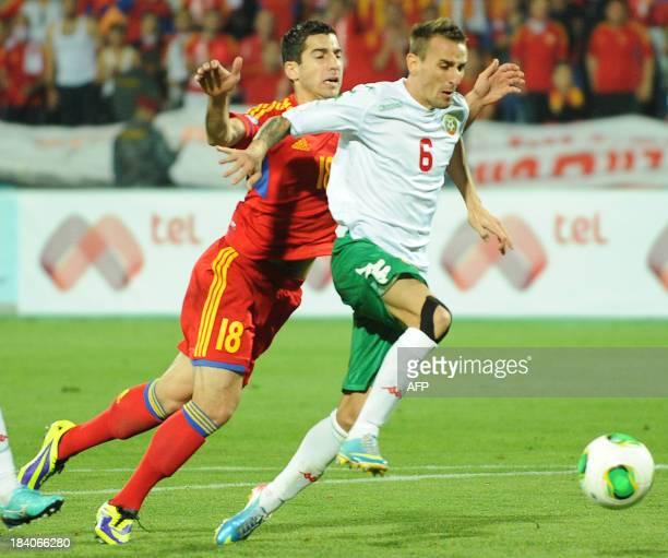 Bulgaria's national football team defender Yordan Minev vies with Armenia's national football team midfielder Henrikh Mkhitaryan during their FIFA...