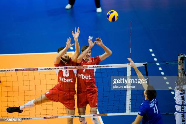 Bulgaria's Nikolaj Nikolow and Miroslaw Gradinarow in action against France's Antonin Rouzier during game of the Olympic Qualification Men's Group B...