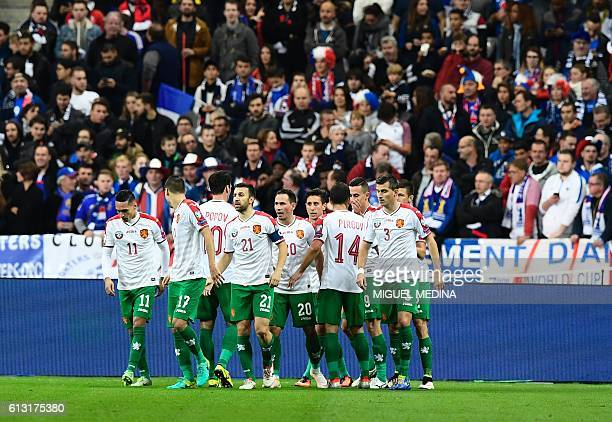 Bulgaria's player celebrate after opening the scoring during the FIFA World Cup 2018 qualifying football match France vs Bulgaria on October 7 2016...