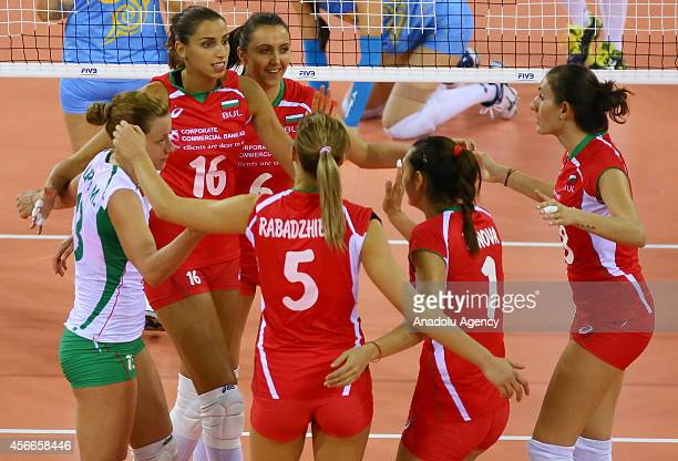 Bulgaria's players celebrate after a point during the 2014 FIVB Volleyball Women's World Championship Group F volleyball match between Bulgaria and...