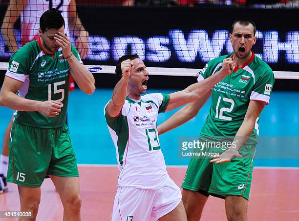 Bulgaria's players Viktor Yosifov Teodor Salparov Teodor Todorov Todor Aleksiev celebrate after winning a point during the FIVB World Championships...
